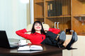 Beautiful smile woman relax in a office Royalty Free Stock Photo