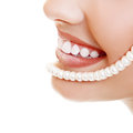 Beautiful smile of young fresh woman with great healthy white te teeth and perls isolated over background Royalty Free Stock Images