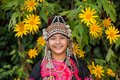 Beautiful smile young hill tribe girl in sunflowers garden. Royalty Free Stock Photo