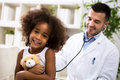 Beautiful smiling afro-american girl with her pediatrician Royalty Free Stock Photo