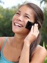 Beautiful smiling asian mobile phone woman Stock Images