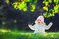Beautiful smiling baby girl sitting on green grass Royalty Free Stock Photo