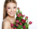 Beautiful smiling blonde woman with flowers Royalty Free Stock Images