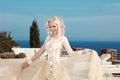 Beautiful smiling bride dressed in elegance white wedding dress Royalty Free Stock Photo