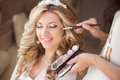 Beautiful smiling bride wedding portrait with makeup and hairsty Royalty Free Stock Photo