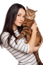 Beautiful smiling brunette girl and her ginger big cat over white background Royalty Free Stock Image