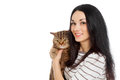 Beautiful smiling brunette girl and her ginger big cat over white background Royalty Free Stock Photo