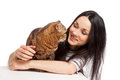 Beautiful smiling brunette girl and her ginger cat over white ba background Stock Image