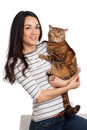 Beautiful smiling brunette girl and her ginger cat over white ba background Royalty Free Stock Photo