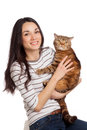 Beautiful smiling brunette girl and her ginger cat over white ba one background Royalty Free Stock Photos