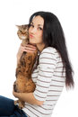 Beautiful smiling brunette girl and her ginger cat over white background Stock Photo