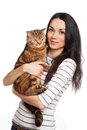 Beautiful smiling brunette girl and her ginger cat over white background Royalty Free Stock Photo