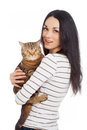 Beautiful smiling brunette girl and her ginger cat over white background Stock Images