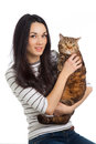 Beautiful smiling brunette girl and her ginger cat over white background Stock Image