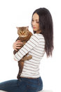 Beautiful smiling brunette girl and her ginger cat over white background one Royalty Free Stock Photo
