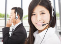 Smiling businessman with call center agent Royalty Free Stock Photo