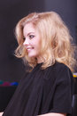 Beautiful smiling girl with blond wavy hair in hairdressing beauty salon Royalty Free Stock Images