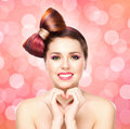 Beautiful smiling girl with a bow haircut and colorful make up on bubble background Stock Photo