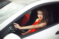 Beautiful smiling girl driver driving in car, sensual brunette m Royalty Free Stock Photo