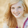 Beautiful smiling girl face portrait close up outdoors Royalty Free Stock Images