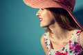 Beautiful smiling girl in a hat in profile Royalty Free Stock Photo