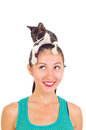 Beautiful smiling girl with a kitten on her head portrait of Royalty Free Stock Photos