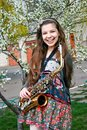 Beautiful smiling girl with saxophone Royalty Free Stock Images