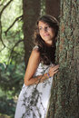 Beautiful smiling girl in the woods natural light portrait of a Stock Photo