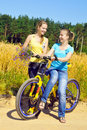 Beautiful smiling girls rest from ride bicycle Royalty Free Stock Photography
