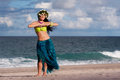 Beautiful, Smiling Hula Dancer on Beach Royalty Free Stock Photo