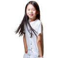 Beautiful smiling little asian girl isolated on yellow background Stock Image