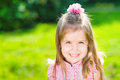 Beautiful smiling little girl with long blond hair closeup outdoor portrait in summer park Royalty Free Stock Photography