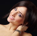 Beautiful smiling make up woman looking happy closeup portrait on black background Royalty Free Stock Images