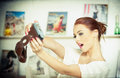 Beautiful smiling red hair woman taking photos of herself with a camera fashionable attractive female taking a self portrait Stock Images