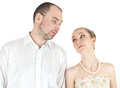 Beautiful smiling wedding couple looking at each other over white background Stock Images