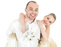 Beautiful smiling wedding couple over white background Royalty Free Stock Images