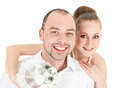 Beautiful smiling wedding couple over white background Stock Image