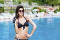 Beautiful smiling woman applying sun-protection cream Royalty Free Stock Photo