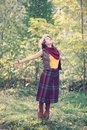 Beautiful smiling woman in bright clothes in the park young standing with open hands Royalty Free Stock Photo