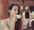 Beautiful smiling woman drinking coffee from cup and looking Royalty Free Stock Photos
