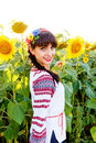 Beautiful smiling woman in  embrodery on a sunflower field Royalty Free Stock Photo