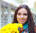 Beautiful smiling woman with flowers in autumn park Royalty Free Stock Photo