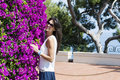 Beautiful smiling woman  in front of bougainvilleas flowers Royalty Free Stock Photo