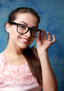 Beautiful smiling woman in glasses on blue Stock Photos