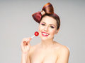 Beautiful smiling woman with a lollipop Royalty Free Stock Photo