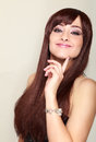 Beautiful smiling woman with long hair thinking Royalty Free Stock Photo