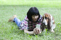 Beautiful smiling woman lying on the grass in the park with your