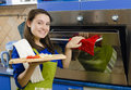 Beautiful smiling woman makes baked food Royalty Free Stock Photos