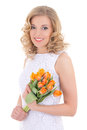 Beautiful smiling woman with orange tulips isolated on white Stock Photo