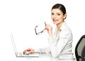 Beautiful smiling woman sits table working laptop white shirt isolated white Royalty Free Stock Images